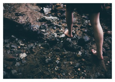 Photo of naked feed walking on stones–mypostcard