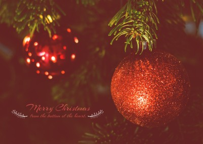 Merry Chritmas with a red Christmas tree ball