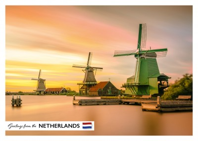 Photo of a windmill near water in the Netherlands–mypostcard
