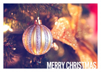 Christmas greeting card with a photo of a christmas tree
