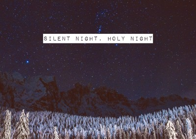 Christmas greeting card wishes silent night, holy night above a fir tree forest