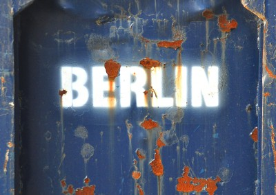 Berlin spray paint on blue
