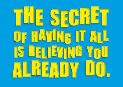 Saying The secret of having it all is believing you already do, written in a yellow font on a blue background