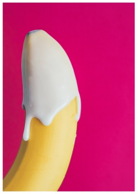 photo banana with white cream dripping over