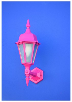 photo pink lantern on blue wall