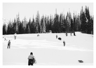 Kids with their sledges on snowy hill