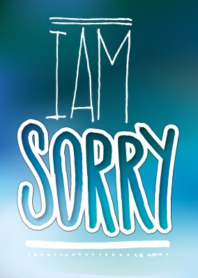 i am sorry in white handlettering on blue fadet background