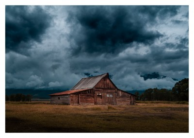 mysterious wooden cabin in the middle of nowhere with cloudy sky
