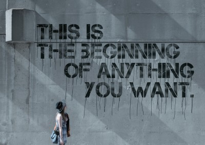 Concret wall with quote: This is the beginning of anything you want.