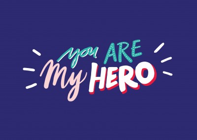 YOU ARE MY HERO escrito a mano sobre fondo azul